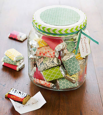 Glass jar filled with paper-wrapped chocolates