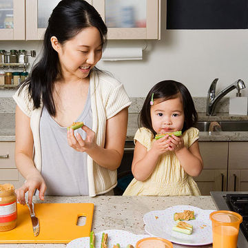 mother and toddler eating healthy snack