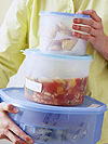 woman holding food in Tupperware