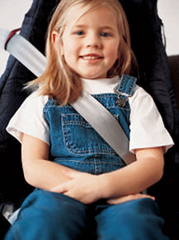 Young girl in car seat