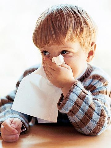 Boy blowing his nose