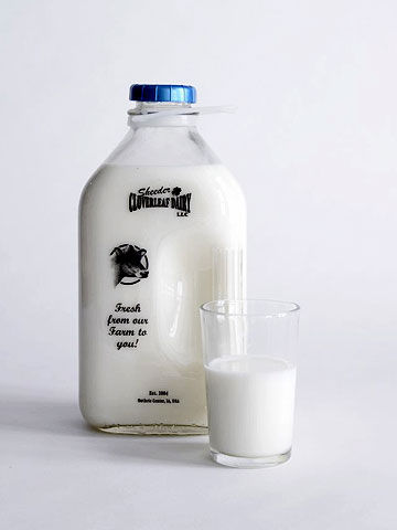 gallon of milk next to glass of milk