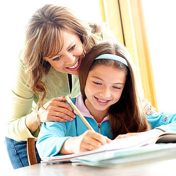 Mom helping Girl with Homework