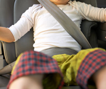 Child with seat belt on