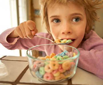 Girl eating sugary cereal