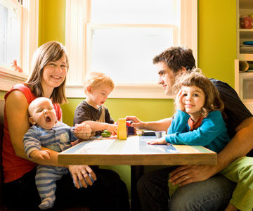 family of five sitting at a table