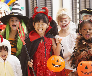children dressed in halloween costumes - The Tradition Of Halloween