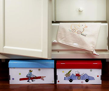 baby's room storage boxes and blankie