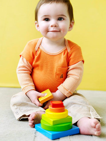 toddler playing with Haba Color Tower Stacking game