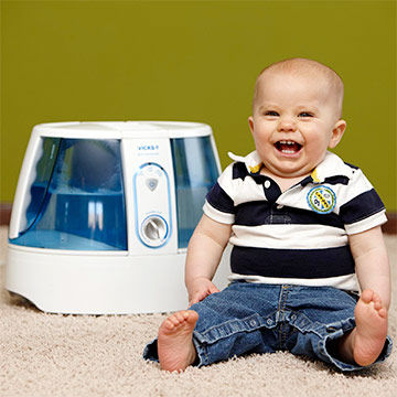 Ethan next to humidifier