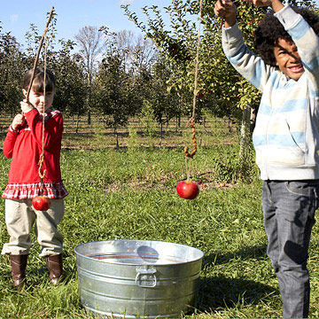 Kid with apple on a string