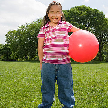child holding ball