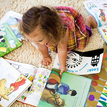 Toddler looking at books