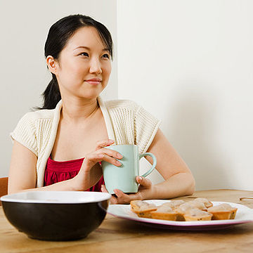 woman holding a cup of tea or coffee