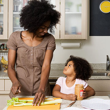 mother and daughter making healthy snacks