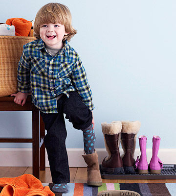 child putting on boots
