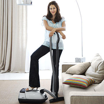 Woman cleaning with vacuum