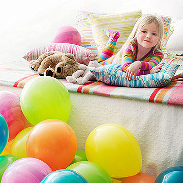 bedroom covered in balloons