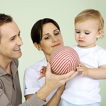 parents playing with toddler
