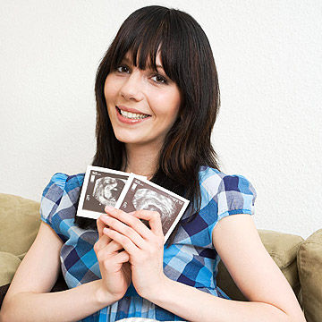 woman holding ultrasound