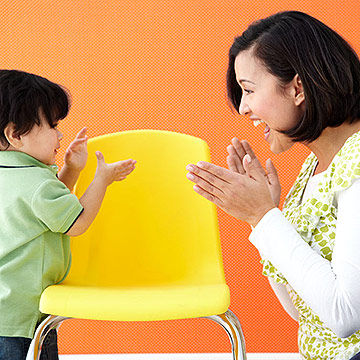 mother and child clapping