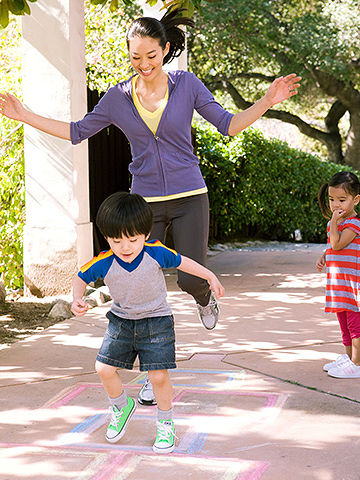mother and son playing hopscotch