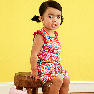 toddler sitting on stool