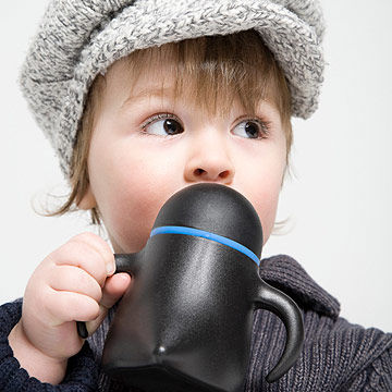 toddler holding sippy cup