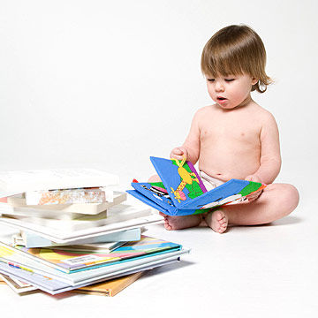 toddler looking at a book