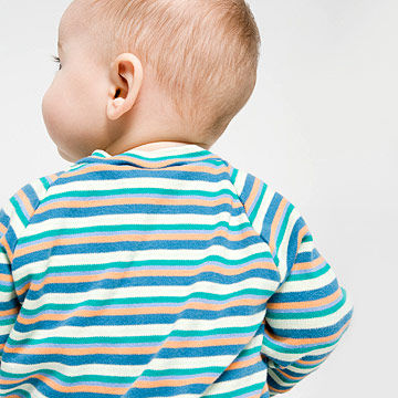 baby in stripes with back to camera