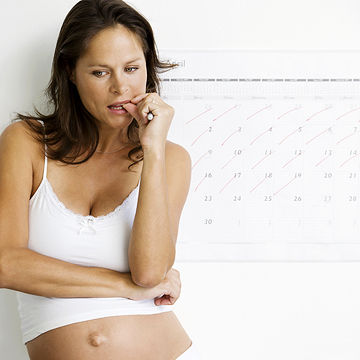 pregnant woman worrying