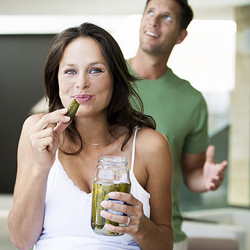 pregnant woman eating pickles