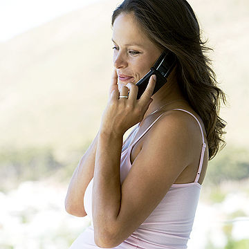 pregnant woman talking on phone