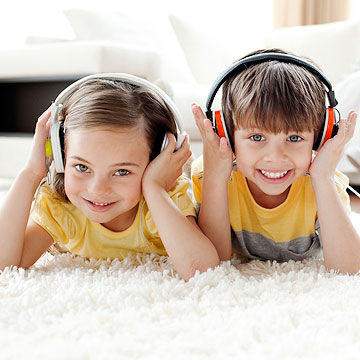 children wearing headphones