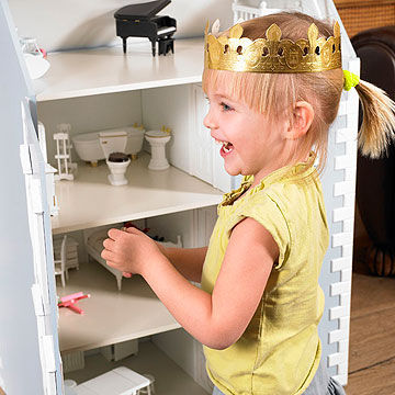 child playing with dollhouse