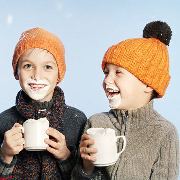 Brothers drinking hot chocolate