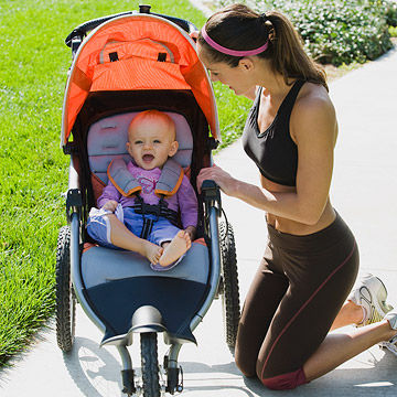 woman pushing running stroller