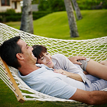 couple lying together on hammock