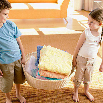children holding laundry basket