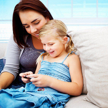 mother and child looking at phone