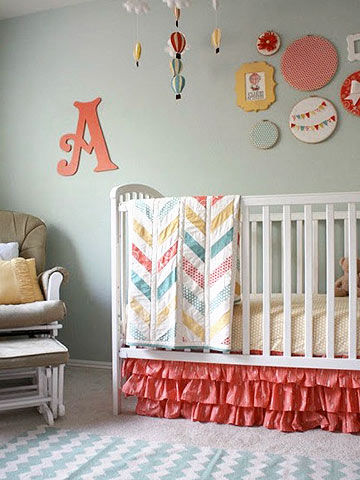 crib with pink ruffled crib skirt