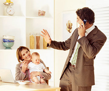 man waving good bye to woman and baby