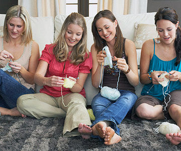 pregnant woman knitting with girlfriends