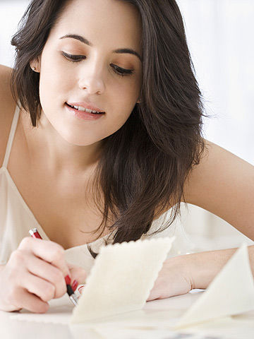 woman writing a note