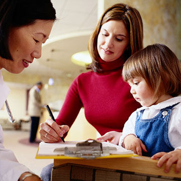 Mother and child filling out paperwork