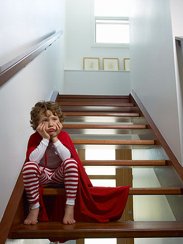 boy sitting on the stairs being punished