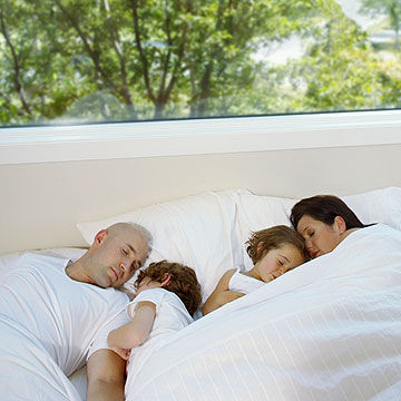 family in bed sleeping