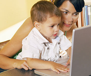 mother and child playing on computer