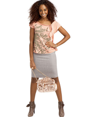 Curly-haired woman in skirt