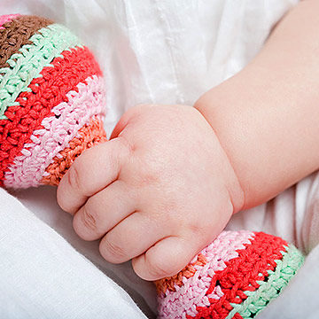 baby holding rattle